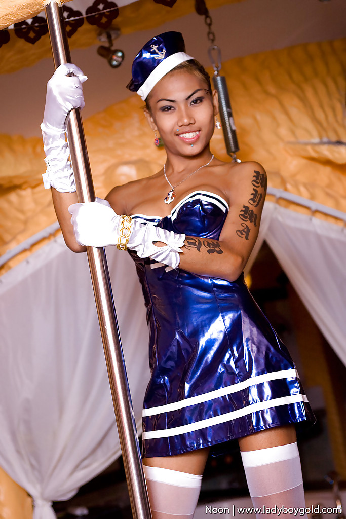 Sexy Thai shemale Noon working the stripper pole in sexy uniform