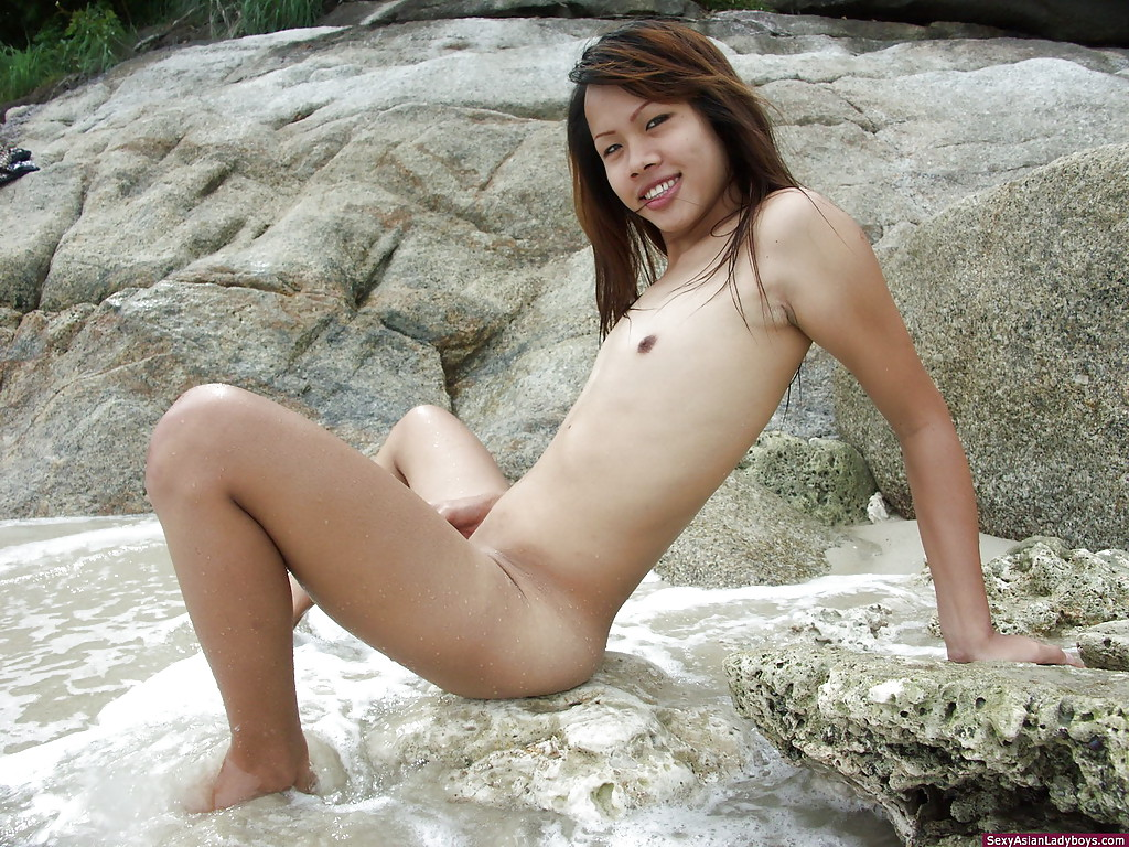 Cute and sexy ladyboy Jane plays with her cock on a tropical beach