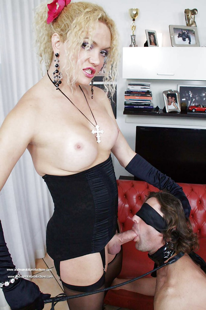 Gorgeous busty blonde shemale dominating her slave with her huge cock