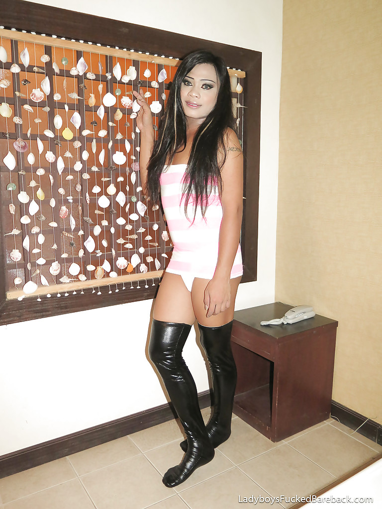 beautiful young ladyboy fern leaves boots on while asshole is