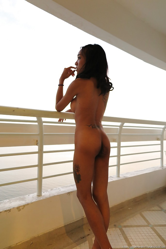 Thin Asian ladyboy heads out onto condo balcony after getting nude